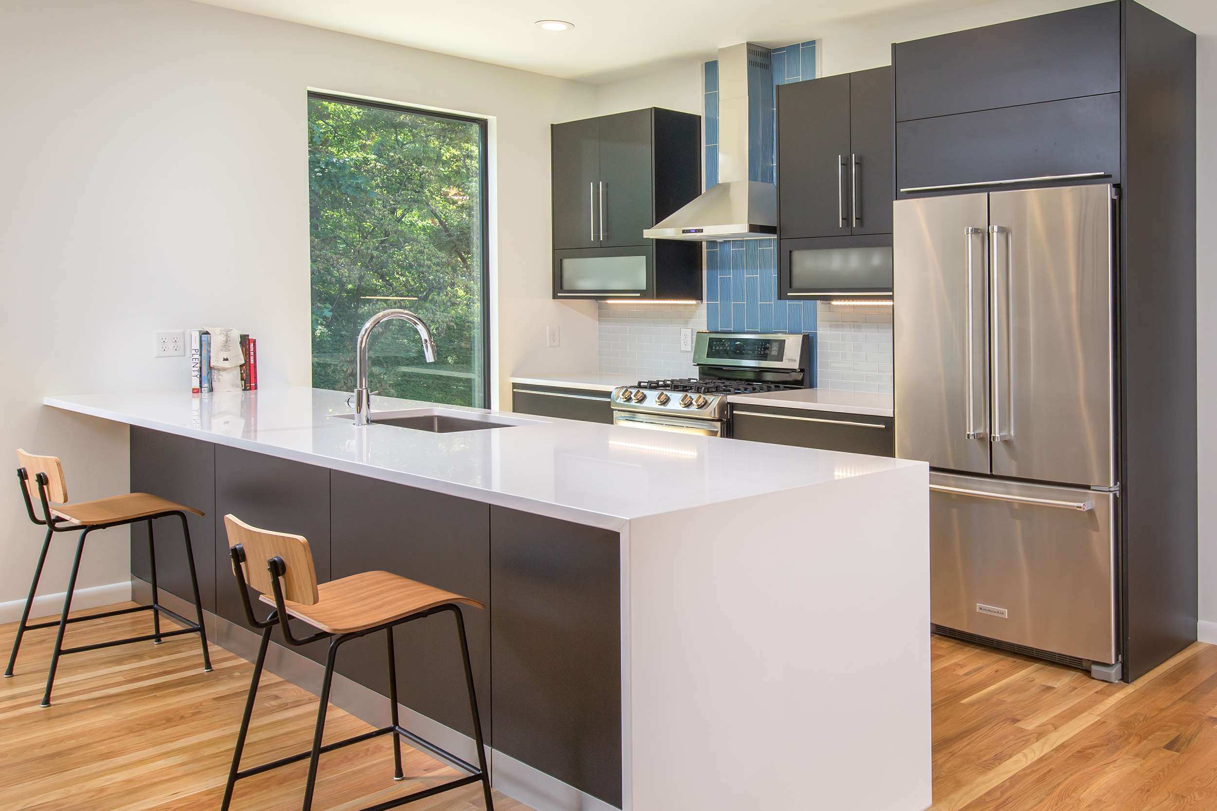 The Kitchen Which Opens Directly Into Dining Area Is A Modern Beauty Stainless Steel Liances Coincide Wonderfully With Gloss White Countertops